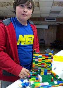 Picture of boy building things with Legos.