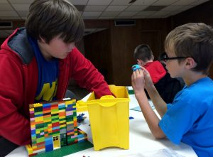 Pictures of kids playing with LEGOs