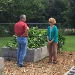 Two people discussing community garden.