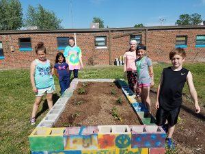 Picture of children standing beside garden