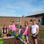 Picture of children watering garden