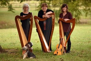 Three women holding harps
