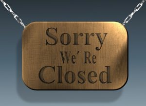 """A board that says """"Sorry we're closed."""""""